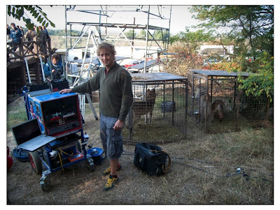 Video Split Operator Jack Warrender at the colesium location set up beside the caged wolves.
