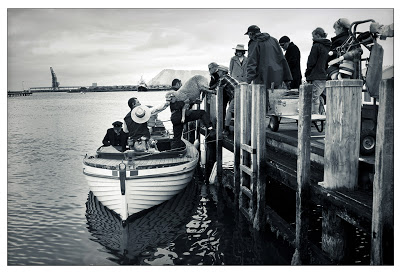 South Solitary crew load sheep and actors into a boat. Portland Jetty, Victoria