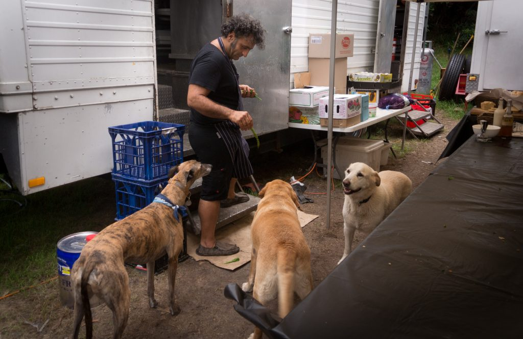 Gracie, Fidel and Tito. Our fantastic caterer Reza Mokhtar disappoints the crew dogs by emerging with asparagus.