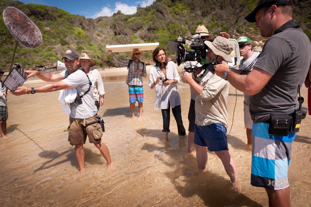 Anne Fontaine, Christophe Beauparte on camera, and crew shooting on Treachery Beach, Seal Rocks.