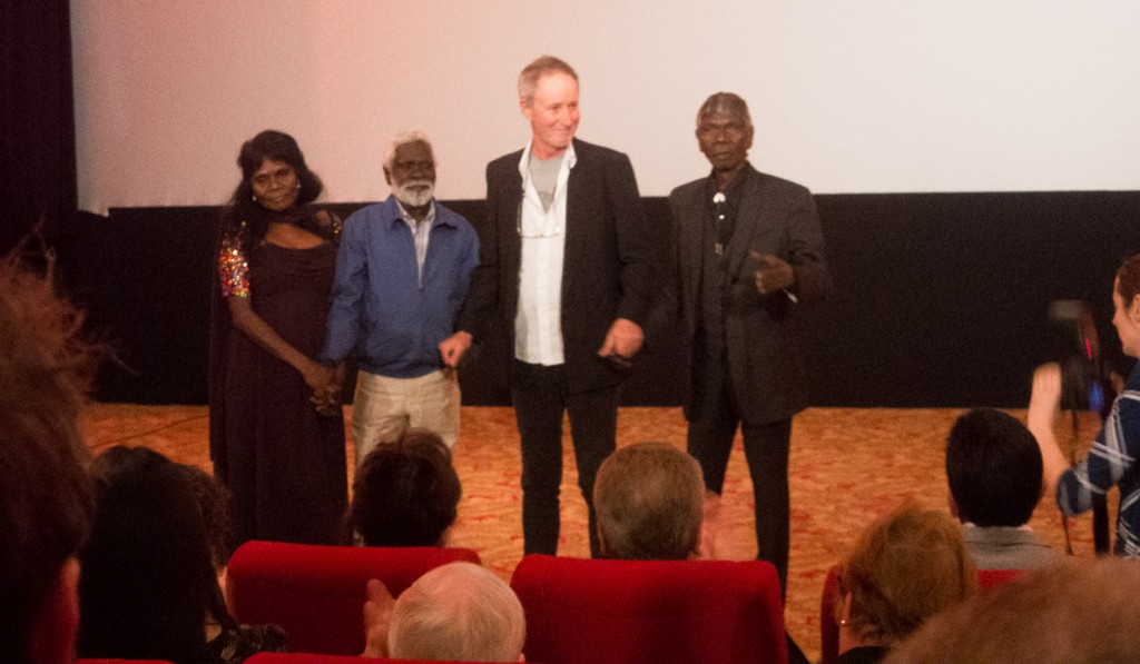 Jennifer Budukpuduk, Peter Djigirr, Rolf de Heer and David Gulpillill recieve applause at the end of the premiere in Adelaide.