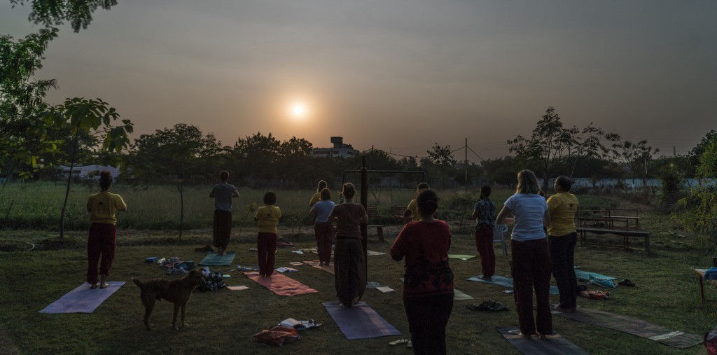 Afternoon yoga class on the lawn at Paramanand Institute in Indore.
