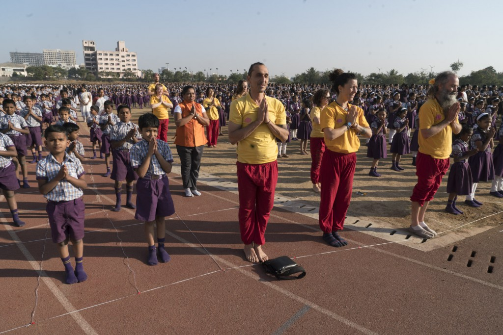 Myself and other Paramanand Yoga students joining 7000 Indian kids for the Sun Salutaion world record